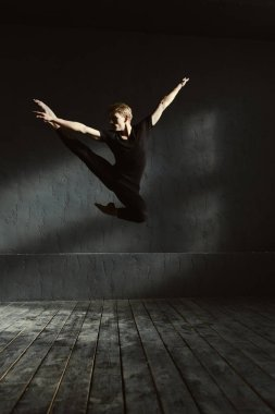 Skilled dancer showing his abilities in the studio