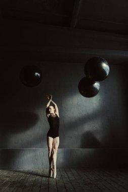 Graceful ballet dancer expressing elegance in the studio