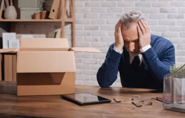Desperate fired businessman overwhelmed with thoughts