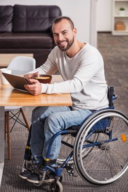 Enthusiastic disabled man having a great morning