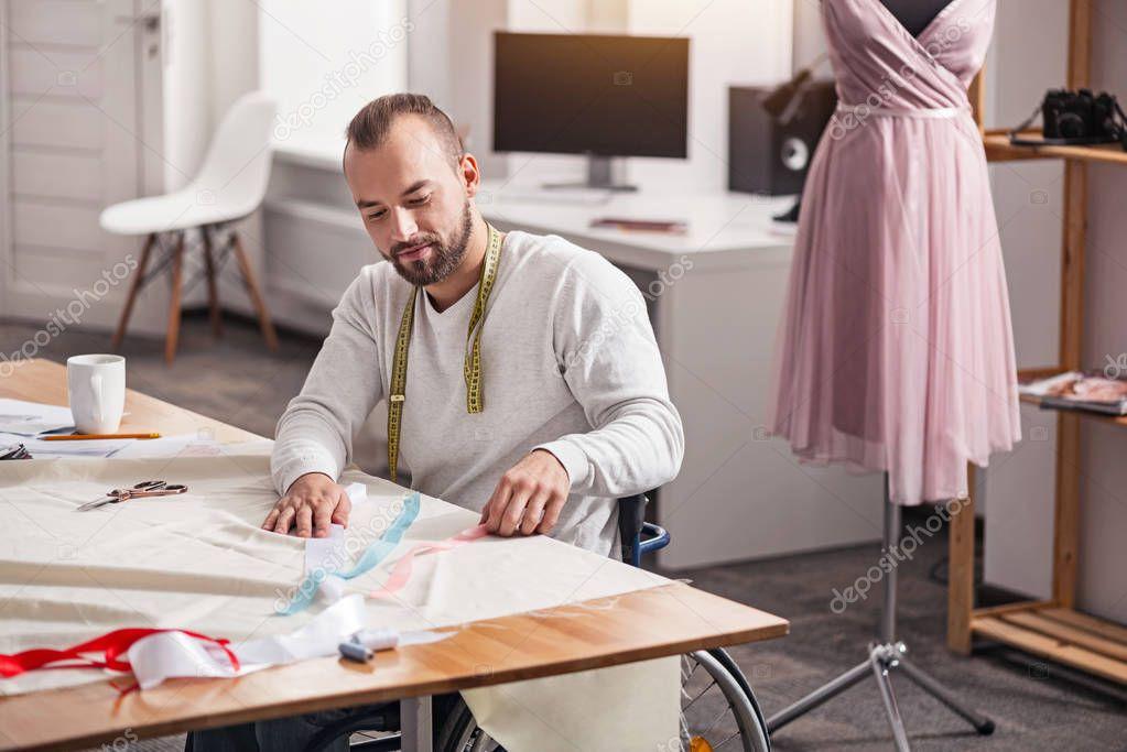 Determined young designer deciding on color scheme