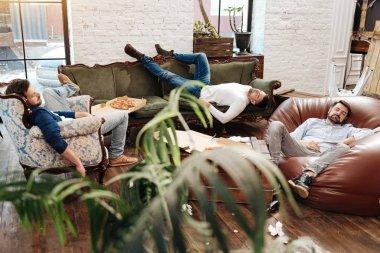 Handsome attractive men sleeping in the living room