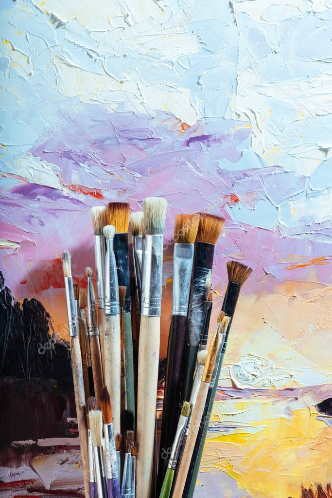 Close up of soft brushes and colorful canvas
