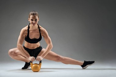 Strong woman holding gym weight