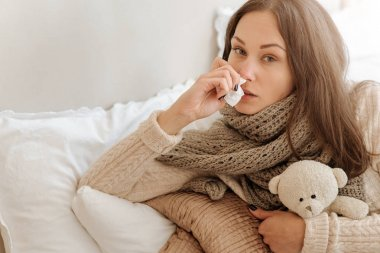 Weak woman snuffling in the bedroom