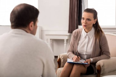 Pleasant nice woman having a psychological session