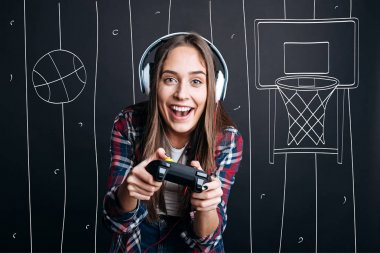 Overjoyed delighted woman plauing video games