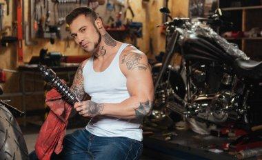 man sitting in the workshop