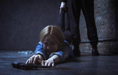 Woman trying reaching gun
