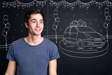 man winning car