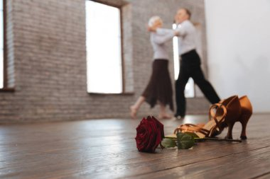 Crafty pensioners tangoing in the dance studio