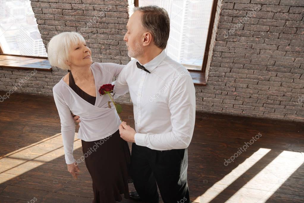 Passionate senior couple tangoing in the dance studio