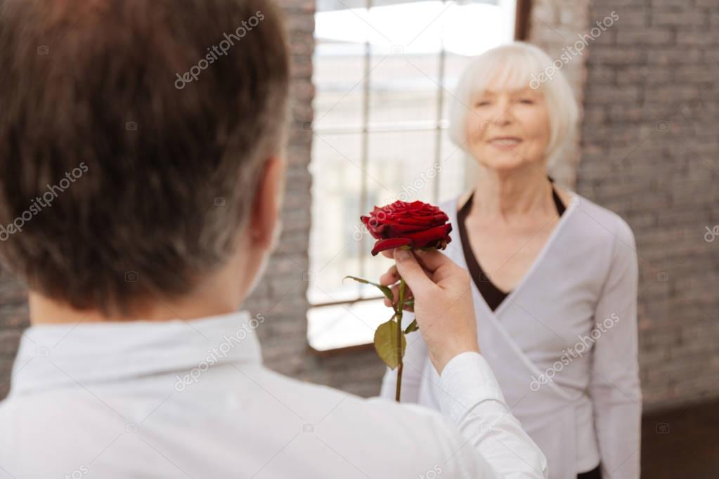 Resolute man expressing love to his wife in the ballroom