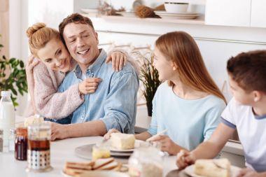 Positive loving parents feeling proud of their children