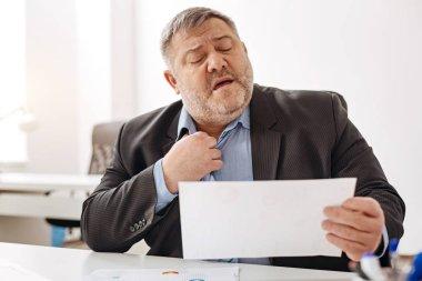 Overwhelmed hard-working man feeling stressed
