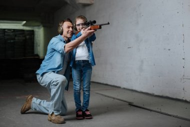 Good looking joyful girl learning to shoot