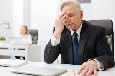 Upset businessman expressing despair in the office