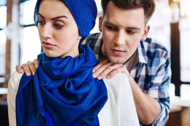 Attractive muslim woman experiencing humiliation from a man