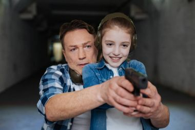 Nice handsome man directing his daughter