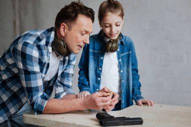 Nice positive man teaching his daughter
