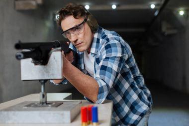 Confident brutal man wearing safety glasses