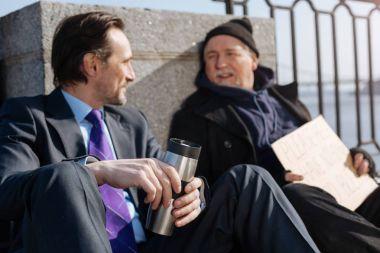 Delighted men having nice conversation