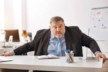 Hardworking distressed employee looking confused