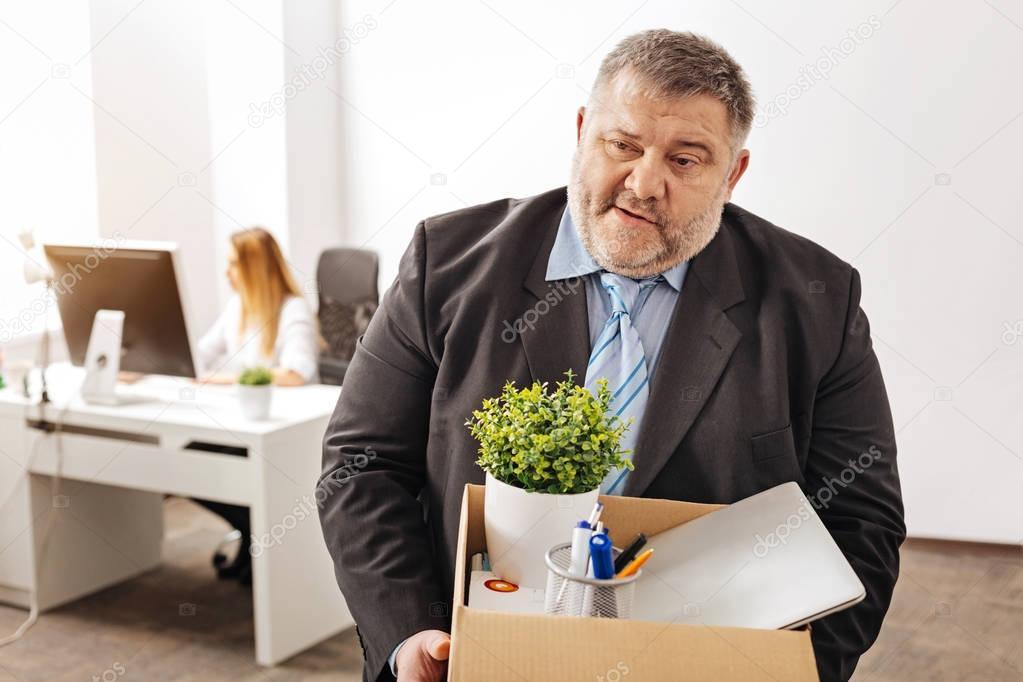 Devastated fired employee being emotional