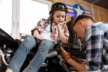 Decent attentive mechanic deciding which wrench to use