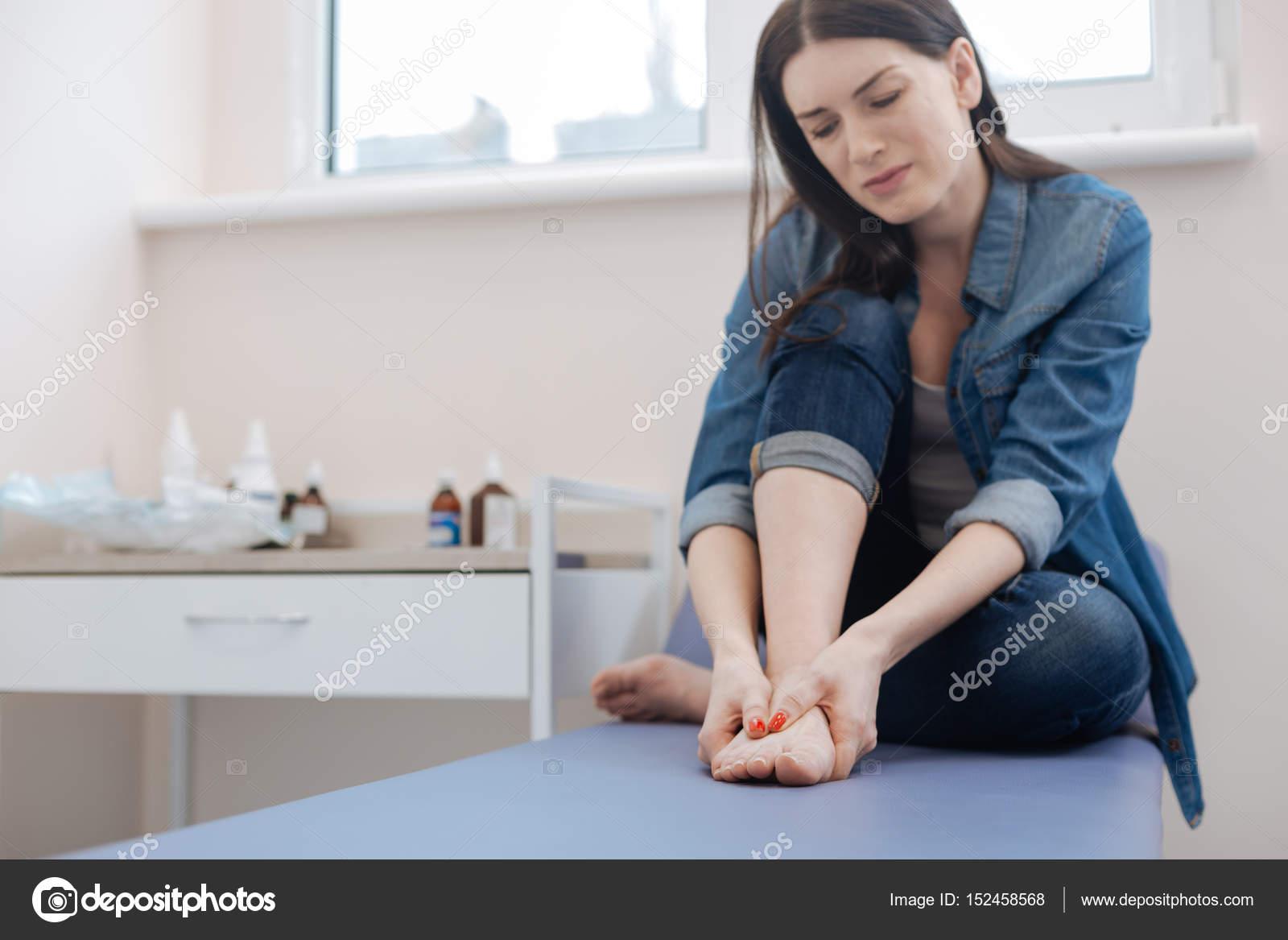 Holding feet girls their