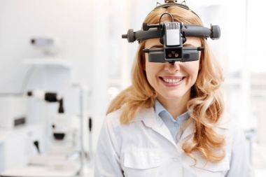 Trained talented ophthalmologist getting used to new equipment