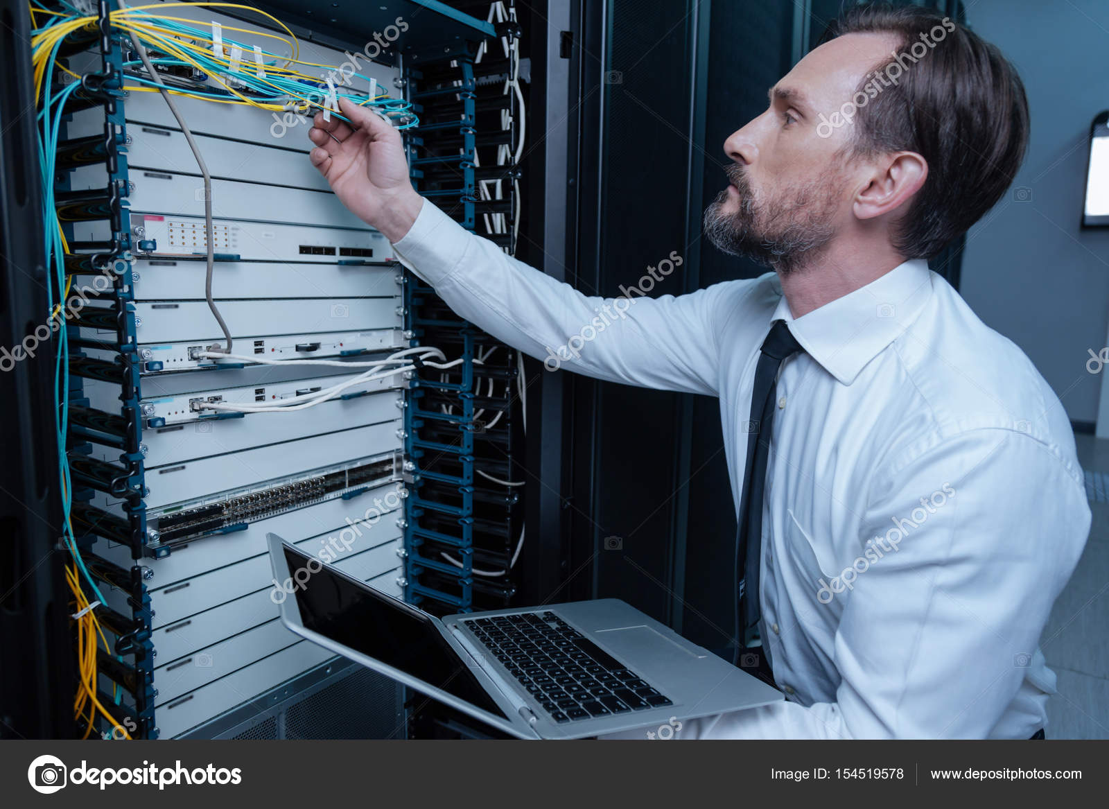 Serious bearded technician checking the wire connection — Stock ...