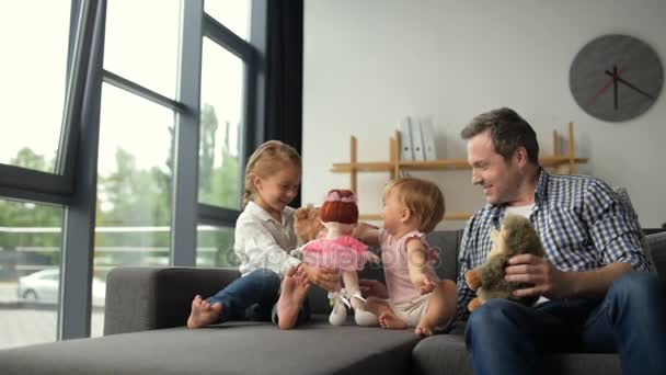 Little girl playing at home with her toddler sister