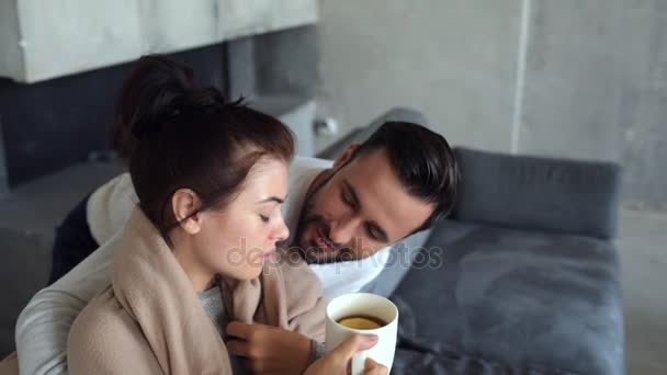 Close up of loving husband taking care of wife