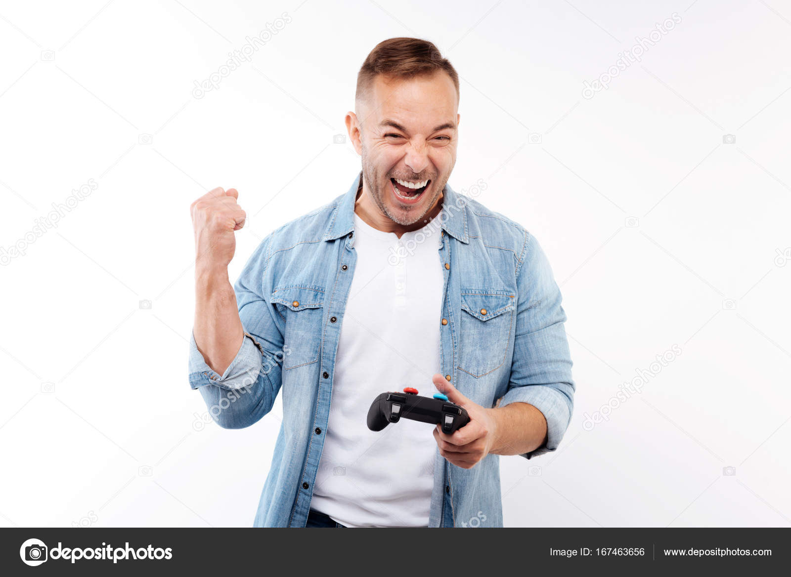 Happy Man Celebrating Victory In Video Game Stock Photo