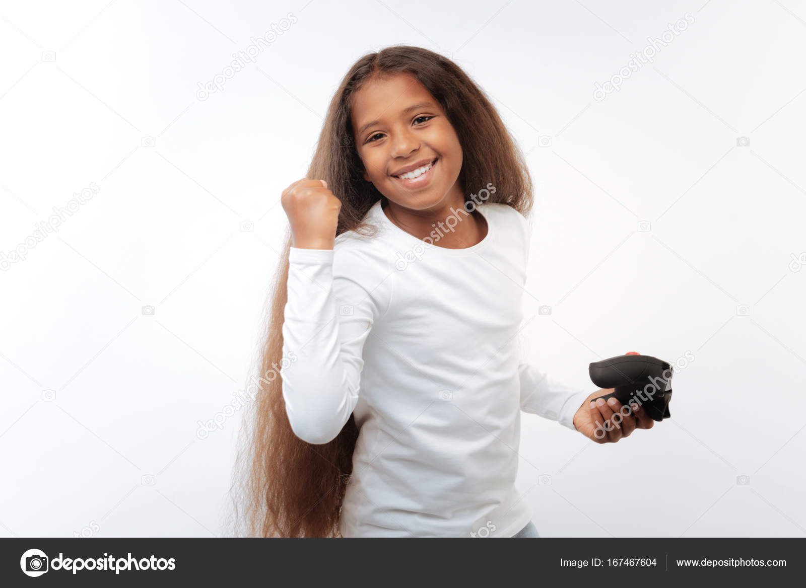 Cute pre-teen girl celebrating victory in video game– stock image