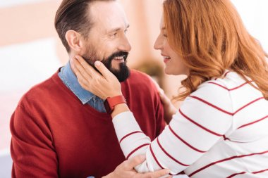 Cheerful man and woman caressing each other