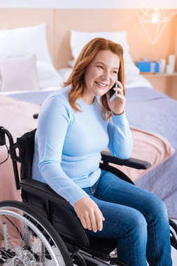 Gleeful handicapped woman talking on the phone