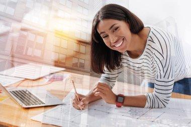 Joyful girl feeling happiness while working