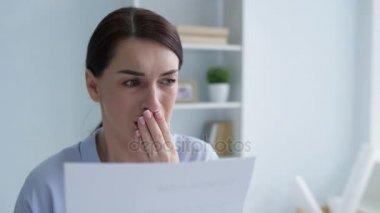 Shocked female employee realizing she is fired