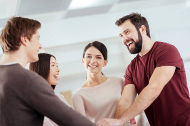 Joyful  four colleagues accomplishing task