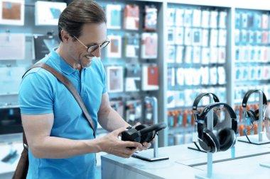 Fanatic music lover choosing headphones