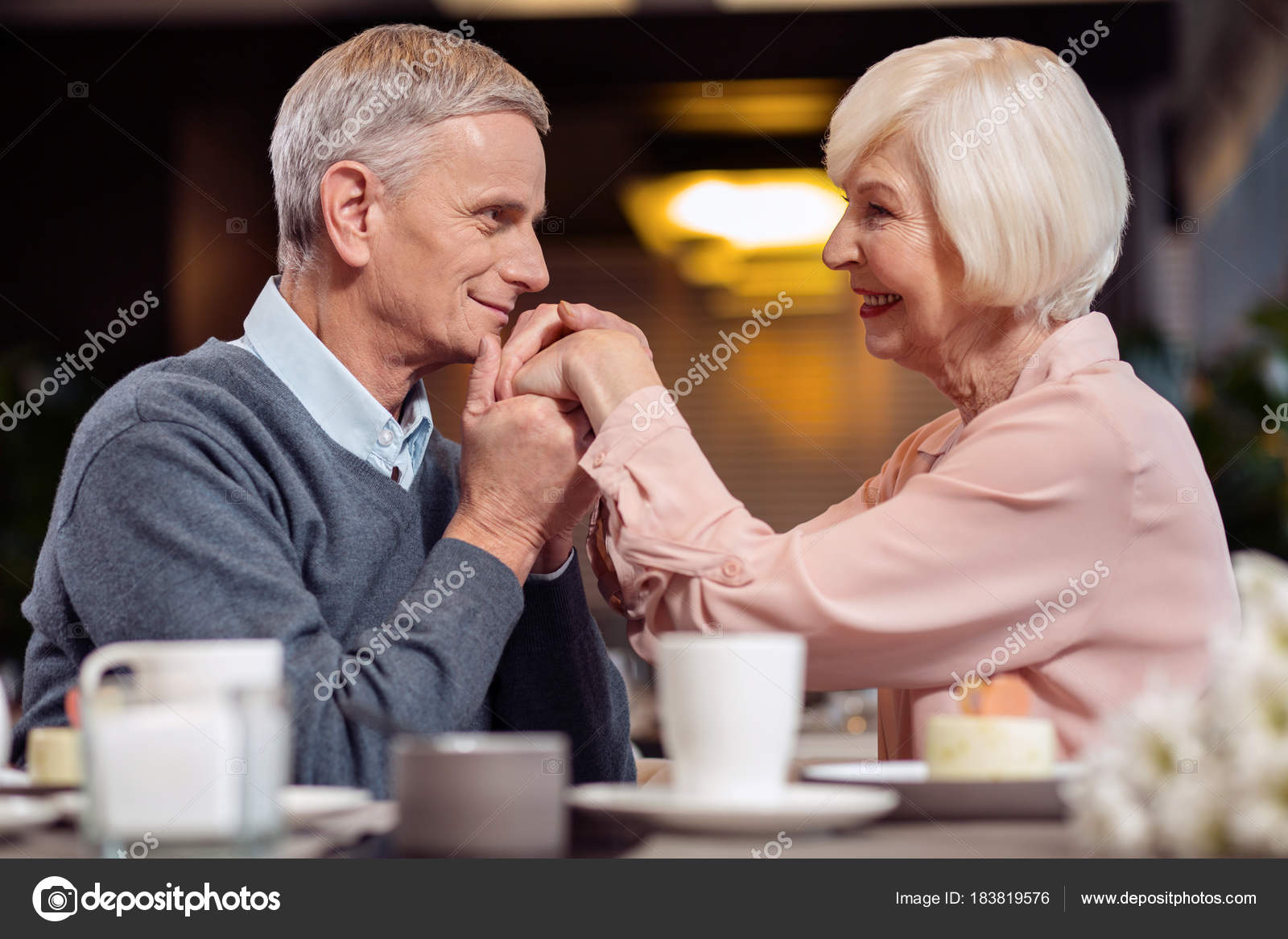 jolly mature man kissing wife hand — stock photo © yacobchuk1 #183819576