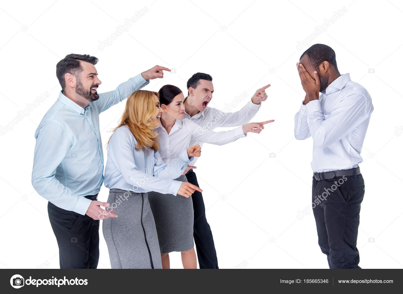 wicked colleagues mocking at their co worker stock photo