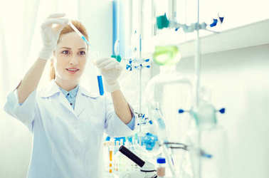 Enthusiastic female scientist conducting chemical experiment