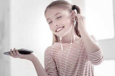 Cheerful girl listening to music