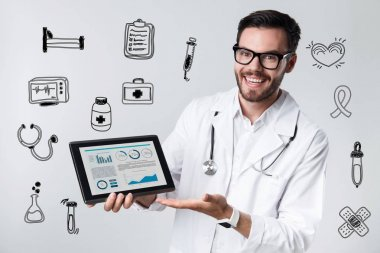Excited medical worker smiling while holding a modern tablet