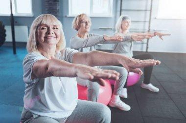 Mature ladies enjoying training session at gym