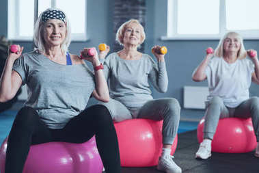 Active retired women during group exercise class