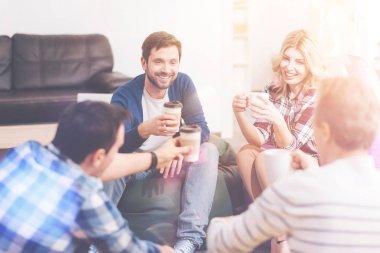 Positive friends drinking coffee